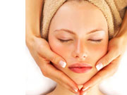woman having facial massage therapy